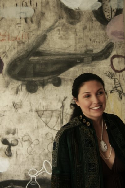 Delia Cabral in front of a painting by Ahmad Shukri Mohamed, in his studio, Malaysia